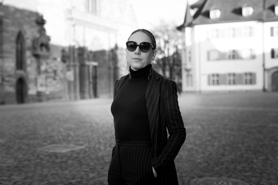 Woman in black on cathedrale square in Basel