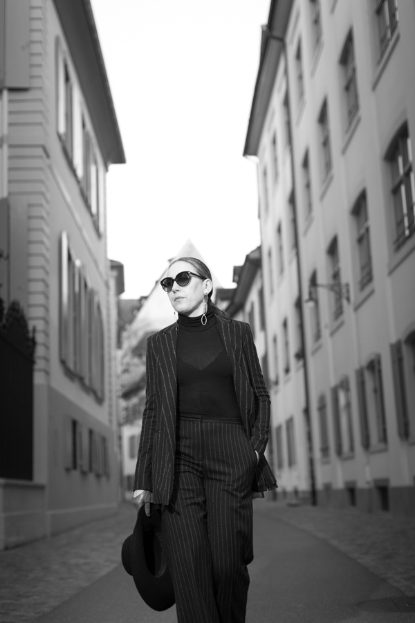 Woman in black on street in historic part of Basel