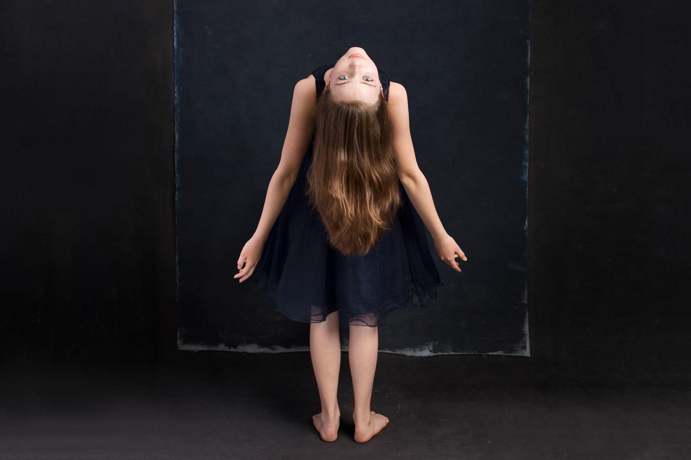 Fine-Art-Portrait-Teen-Girl-in-blue-dress-bending-backward
